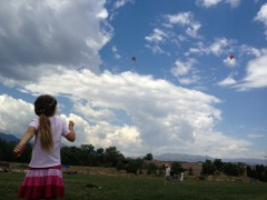 Two Kites and Katie Beth Flying Them