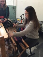 Karen Allen working loom
